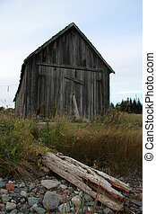 Old Boat House - An old boat house viewed from the shore...