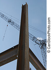 Getting built - Construction crane and steel girders against...