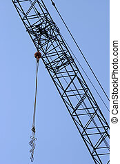 Tall job - Construction crane against blue sky