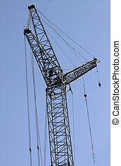 Sky crane - Construction crane against blue sky