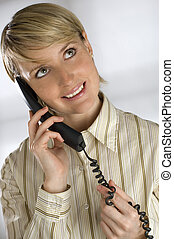 phone - young business woman talking on telephone portrait