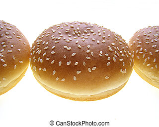 burger bun - Close-up of burger bun with sesame seeds on...
