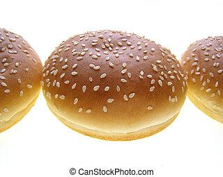 burger bun - Close-up of burger bun with sesame seeds on...