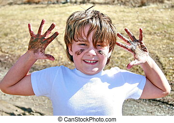 muddy kid in the spring - A child playing in the mud Spring...