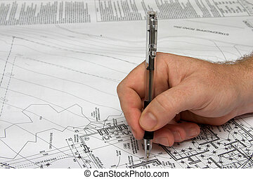 Architect drawing a plan. - Architect checking the plan with...