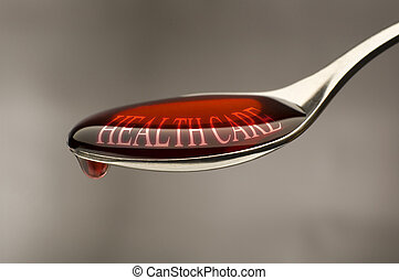 sirup - red sirup on a spoon with health care text on it