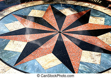 Compass Rose - A colorful design on a walkway depicting a...
