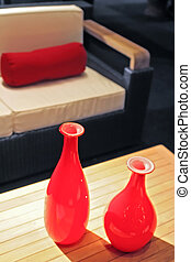 red vases in interior