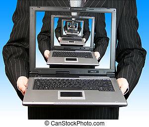 Businessman laptop - Businessman holding a laptop