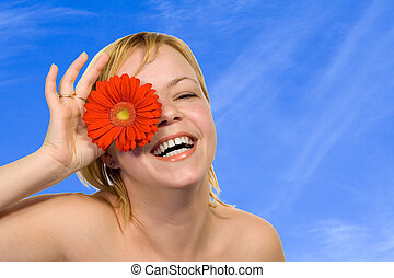 Spring skies and flower fun - Young radiant happy woman...
