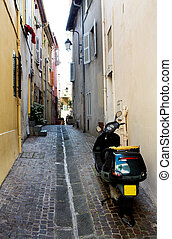 Backstreet scooter - Black scooter on the backstreets of...