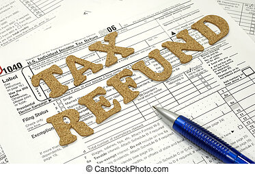 Tax Refund - Photo of Tax Forms and a Pen - Tax Related