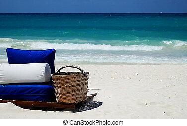 blue bedding on white sand