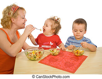 The joy of eating healthy - Mother and children, boy and...