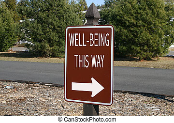 Well-Being This way - This sign shows the way to well-being...