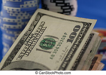 Poker chips and money - Poker chips and a couple of hundred...