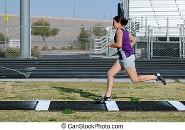 Long Jump - Teenage girl practicing long jump...