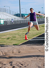 Long Jump - Teenage girl practicing long jump