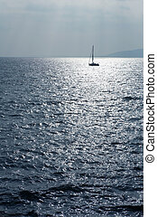 StRaphael 8 - Single sailboat on the Mediterranean Sea blue...