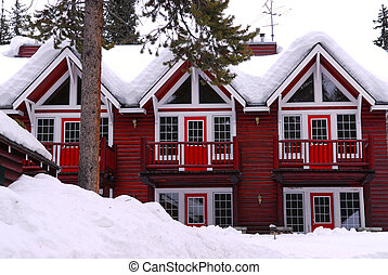Winter lodge - Log building of a mountain lodge in winter at...
