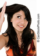 Hair Health - How healthy is your hair? A woman looking at...