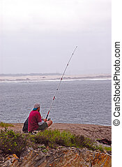 Fishing At Pismo Beach, California, USA - Two people fishing...