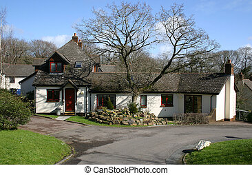 bungalow and tree - large bungalow in a small village...