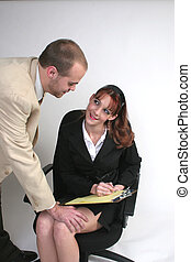 Bosses flirt - A man in a business suit has his hand on a...