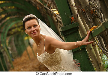 Beautiful bride - The beautiful smiling bride one in park