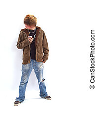 Teen Boy with MP3 Player - Teenage boy listening to a MP3...