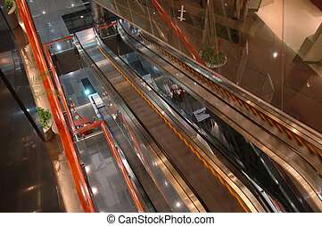 The escalators in airport entertainment center - The...