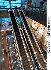 The escalators in entertainment center - The escalators in...