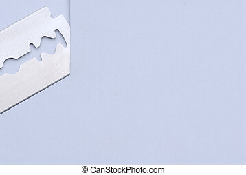 Razor blade is cutting paper with free space