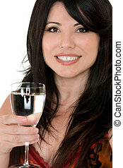 Drink to good health - Healthy choices A woman with a glass...