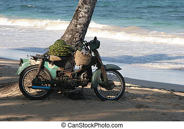 beach bike - old motor bike on a Dominican Republic beach