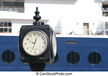 Ships Time - Cruise ship tied up at a dock with a clock in...
