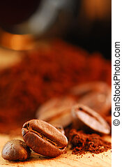 Coffee beans and ground coffee - Macro image of coffee beans...