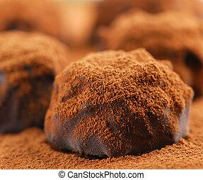Chocolate truffles - Macro image of dark chocolate truffles...