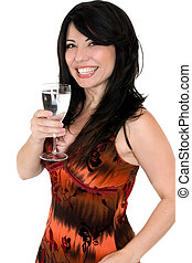 Celebrate good health - Vibrant smiling woman with a glass...