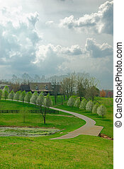 Kentucky Farm On A Stormy Day - A winding road lined with...