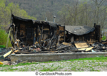 Burned, Fire Damaged Home - The charred ruins of a burned...