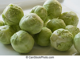 Brussels sprouts - Raw Brussels sprouts with water droplets....
