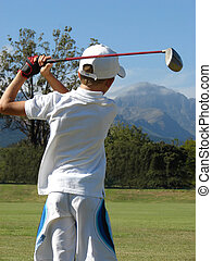 Youngster - Young golfer after hitting a ball on the golf...