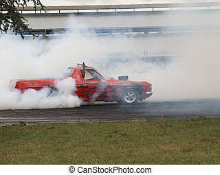 Smokin Ute - A ute spinning the wheels to produce smoke...