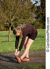 Woman Stretching - Young Woman Stretching in a Park