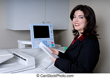 Office Work - Young Woman Doing Some Photocopying At The...