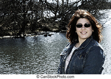 Young Woman - Photo of a Young Woman Outdoors By a Lake