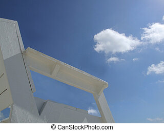 Watchman - An empty lifeguard chair seat overlooking the sky...