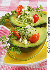 Avocado with a vegetable stuffing from tomatoes, cucumbers...