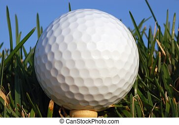 Golf ball on a tee at close range Great perspective